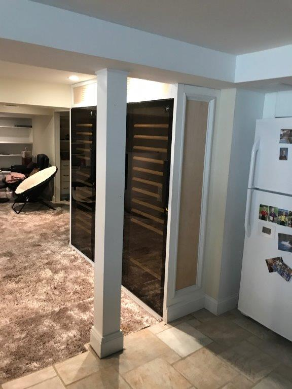 Wine Fridge In Finished Basement Area